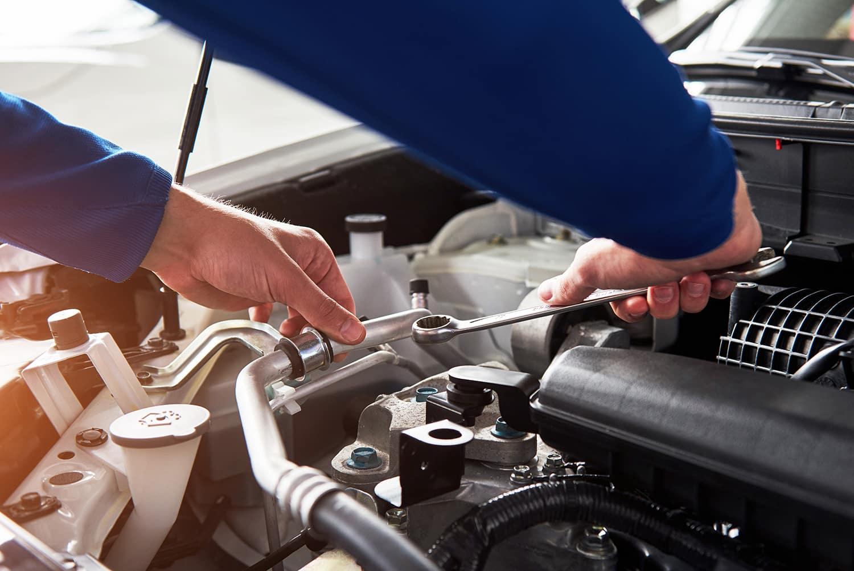 Washington Hyundai is a Hyundai Dealership in Washington near Meadowlands, PA   Mechanic working under the hood of car