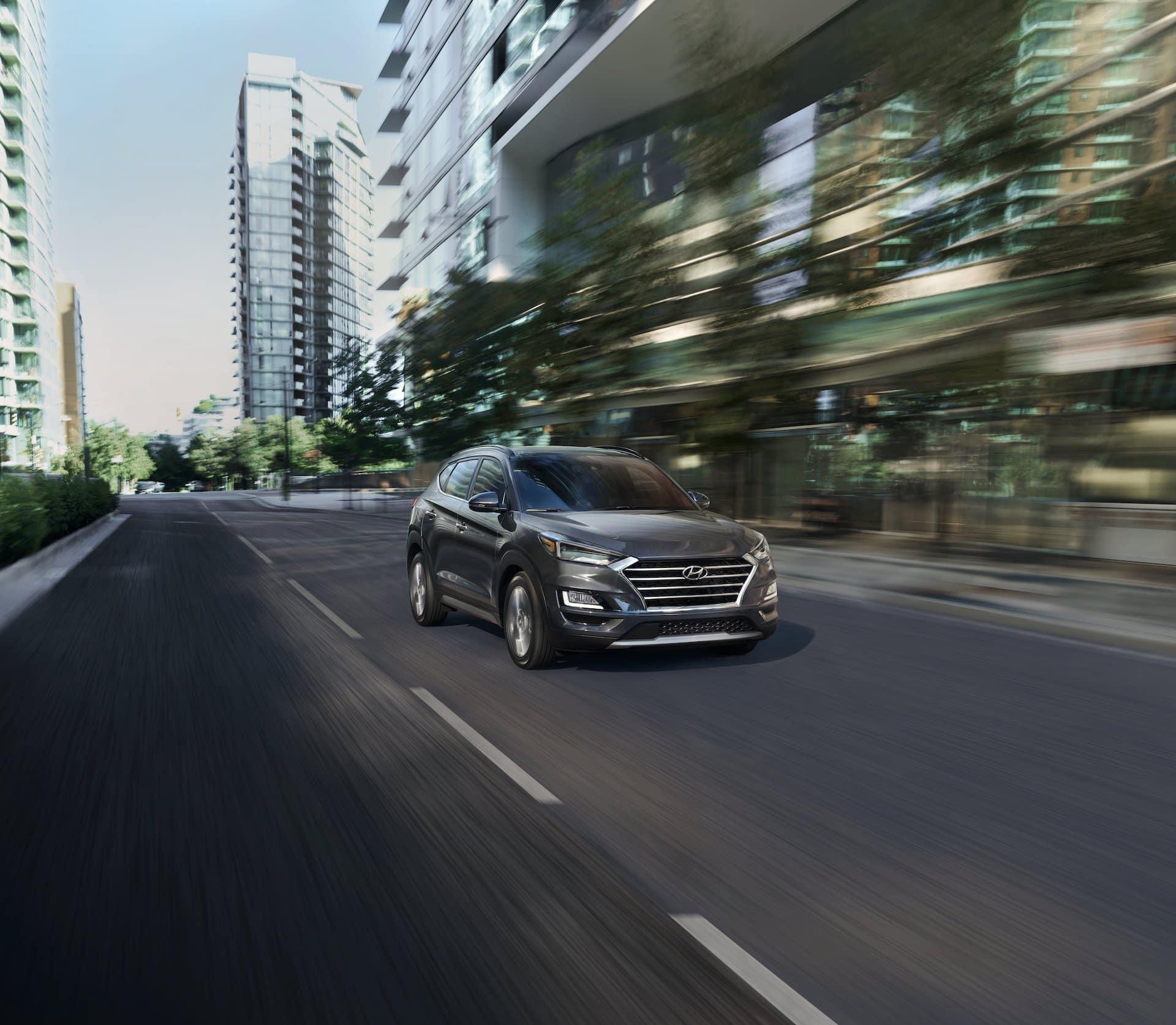 Washington Hyundai is a Hyundai Dealership in Washington near McGovern, PA | Hyundai Tucson driving fast through city