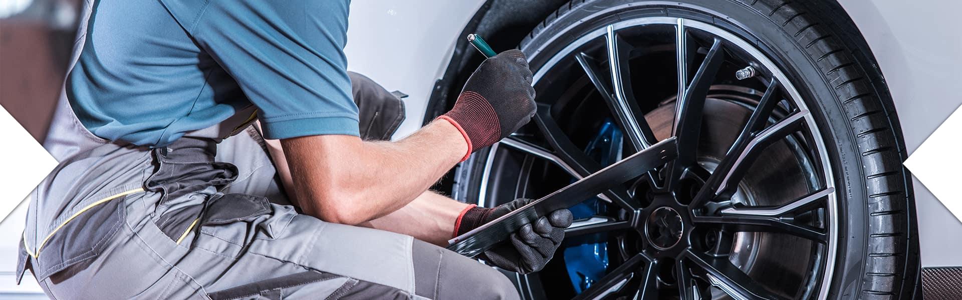 Washington Hyundai is a Hyundai Dealership in Washington near McMurray, PA   Service Advisor Checking Tires on Vehicle