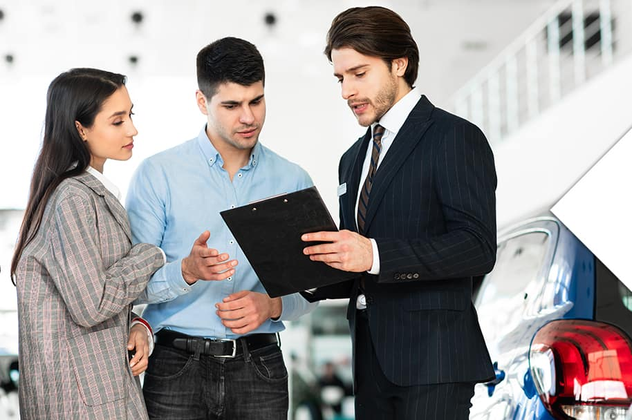 Washington Hyundai is a Hyundai Dealership in Washington near McMurray, PA   Couple Talking to Sales Advisor in Dealership