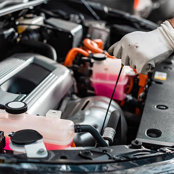 Benefits of Changing Your Hyundai's Oil at Washington Hyundai in Washington   Service Advisor Pulling Oil Dip Stick Out of Engine